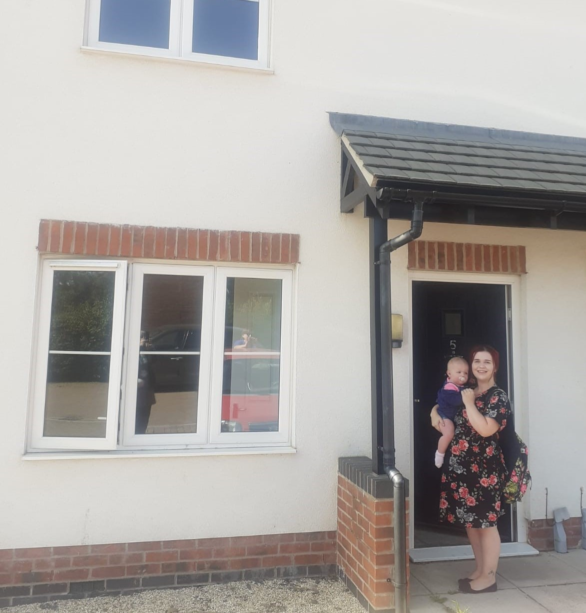Leanne and daughter outside new home